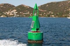 Green buoy with solar battery, canal border mark stock photography