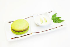 Green burger dessert. Dessert pistachio green burger with chocolate and cream Stock Images