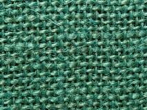 Green burlap fabric texture background Stock Image