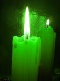 Green burning candles Stock Photos