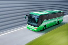 Green bus. Travel green bus on the road Stock Photography