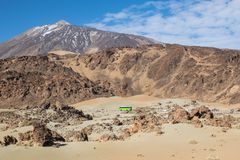 Green bus in front of mountains royalty free stock images
