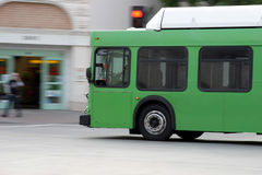 Green bus on the street. Of LA Stock Photo