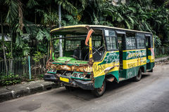 Green Bus wrackage ababdoned on side the street photo taken in Jakarta Indonesia Stock Photo