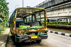 Green Bus wrackage abandoned on side the street near flyover bridge photo taken in Jakarta Indonesia Stock Photo