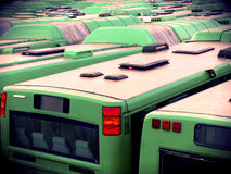 Green Buses. Tightly parked green buses in the city of Malmoe stock image