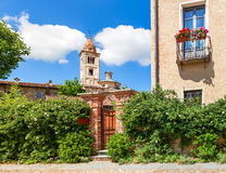 Green bushes and parish church in Italy. Royalty Free Stock Photos