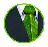 Green Business Badge. Business suit and green leaves as tie representing a natural job in the shape of a badge Stock Images