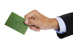 Green Business Card. Man giving out a green business card or paying using an ecofriendly credit card royalty free stock photo