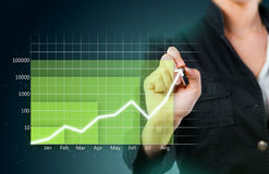 Green business graph showing growth. Close up Stock Photo