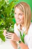 Green business office woman smiling plants Royalty Free Stock Image