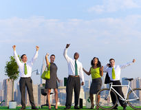 Green Business People Celebrating on Building Stock Photos