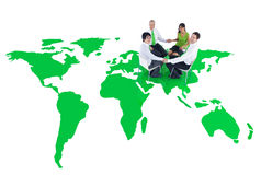 Green Business People Holding Hands on Green World Stock Photography
