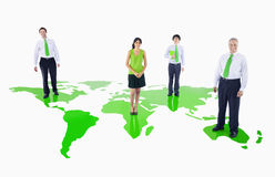 Green Business People Standing on a Green World Royalty Free Stock Images