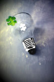 Green business successful ideas. Green jigsaw puzzle piece to complete lightbulb Royalty Free Stock Photos