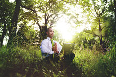 Green Businessman Meditation Technology Peaceful Concept Royalty Free Stock Image