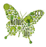 Green butterfly with environmental icons Stock Images