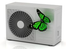 Green butterfly sits on a street conditioner Royalty Free Stock Images