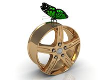 Green butterfly sits under the gold rims Royalty Free Stock Image