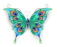 Green butterfly. Butterfly with green wings, decorated with blue circles on a White background Stock Photo