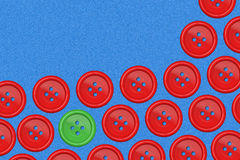 green button amongst group of red Buttons - Make a difference co Royalty Free Stock Photo