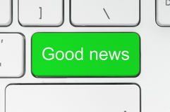 Green button with good news words on the keyboard. Close-up royalty free stock photo
