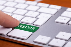 Green button on keyboard with webinar word on it Royalty Free Stock Photo