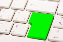 Green button on a white keyboard royalty free stock photos