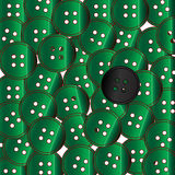 Green Buttons. A collection of green buttons with the odd one out being black Stock Photography