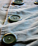 Green Buttons on Green Jacket Royalty Free Stock Photos