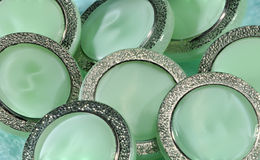 Green buttons with metal frame. Royalty Free Stock Photo