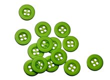 Green buttons on white. Fourteen bright green button isolated on white royalty free stock photos