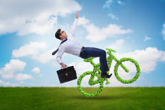 The green bycycle in environmentally friendly transportation concept Stock Photo