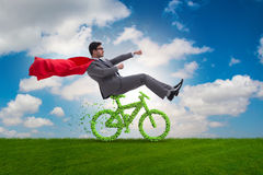 The green bycycle in environmentally friendly transportation concept Stock Images