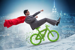 The green bycycle in environmentally friendly transportation concept Stock Photos