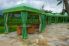 Green Cabanas with Tables and Chairs Royalty Free Stock Photography