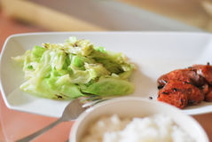 Green cabbage and chinese sausages. Fried cook for braunch  wiht thai jasmine rice in white dish and cup Stock Image