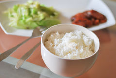 Green cabbage and chinese sausages. Fried cook for braunch  wiht thai jasmine rice in white dish and cup Royalty Free Stock Image