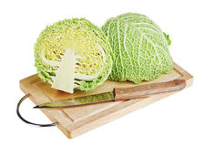 Green cabbage with knife on wooden chopping board Stock Images