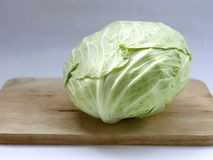 Green cabbage on wood cutting board. Thai green cabbage food ingredients on cutting board stock images
