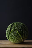 Green Cabbage on Wood Plank Table Royalty Free Stock Photography