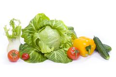 Green cabbage. Yellow pepper. Red tomatoes and cucumbers on a white background. Composition from different vegetables on a white background royalty free stock image
