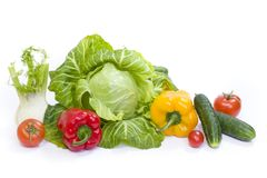 Green cabbage. Yellow pepper. Red tomatoes and cucumbers on a white background. Composition from different vegetables on a white background stock image