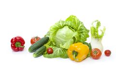 Green cabbage. Yellow pepper. Red tomatoes and cucumbers on a white background. Composition from different vegetables on a white background stock photo