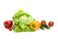 Green cabbage. Yellow pepper. Red tomatoes and cucumbers on a white background. Composition from different vegetables on a white b. Ackground royalty free stock photo