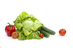 Green cabbage. Yellow pepper. Red tomatoes and cucumbers on a white background. Composition from different vegetables on a white b. Ackground royalty free stock photos