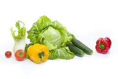Green cabbage. Yellow pepper. Red tomatoes and cucumbers on a white background. Composition from different vegetables on a white background royalty free stock photo