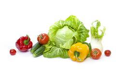 Green cabbage. Yellow pepper. Red tomatoes and cucumbers on a white background. Composition from different vegetables on a white background stock images