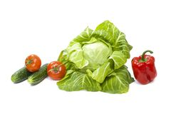 Green cabbage. Yellow pepper. Red tomatoes and cucumbers on a white background. Composition from different vegetables on a white b. Ackground stock images