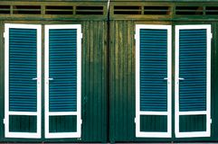 Green cabins changing rooms beach background texture Royalty Free Stock Photo